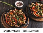 roasted meat and vegetables on... | Shutterstock . vector #1013604031