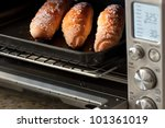 Buns in oven - stock photo