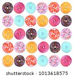 doughnuts on an isolated white... | Shutterstock . vector #1013618575