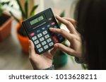 woman working with calculator | Shutterstock . vector #1013628211
