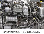 Small photo of Engine of fighter jet, internal structure with hydraulic, fuel pipes and other hardware and equipment, army aviation, military aircraft and aerospace industry