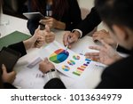 a group of business men and... | Shutterstock . vector #1013634979
