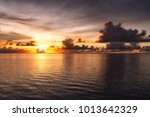 sunset of the pacific in guam | Shutterstock . vector #1013642329