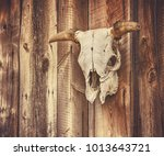wall with a steer or cow skull... | Shutterstock . vector #1013643721