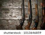 hunting guns frame on wooden... | Shutterstock . vector #1013646859