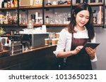barista woman using digital... | Shutterstock . vector #1013650231