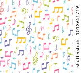 seamless pattern with music... | Shutterstock .eps vector #1013651719