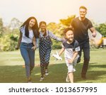 family running with son and... | Shutterstock . vector #1013657995