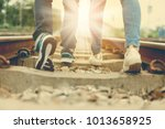 Small photo of Lovers walk together on railway,loving couple walking outdoor,Walking forward to destination,concept of soulmate,lover and a life partner