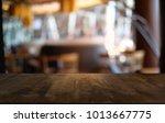 empty wooden table in front of... | Shutterstock . vector #1013667775
