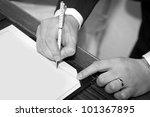 Married couple signing marriage registration form - stock photo