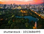 lumpini park and bangkok city... | Shutterstock . vector #1013686495
