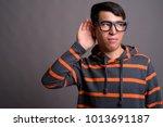 studio shot of young asian nerd ... | Shutterstock . vector #1013691187