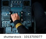 captain hand accelerating on... | Shutterstock . vector #1013705077
