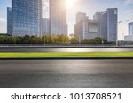 empty road with modern business ... | Shutterstock . vector #1013708521