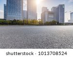 empty road with modern business ... | Shutterstock . vector #1013708524