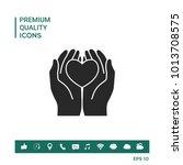 hands holding heart  ... | Shutterstock .eps vector #1013708575