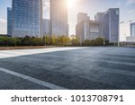 empty road with modern business ... | Shutterstock . vector #1013708791