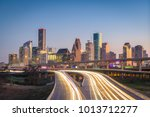 Houston, Texas, USA downtown city skyline and highway.
