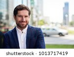 smiling young businessman...   Shutterstock . vector #1013717419