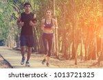 couple runner working on... | Shutterstock . vector #1013721325