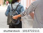 thief stealing smart phone from ... | Shutterstock . vector #1013722111