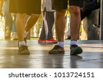 people wearing shoes are... | Shutterstock . vector #1013724151