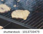 preparation of cheeseburgers on ... | Shutterstock . vector #1013733475