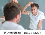 hair loss man looking in... | Shutterstock . vector #1013743234