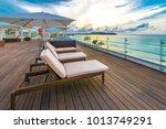 beautiful tropical wooden deck... | Shutterstock . vector #1013749291