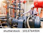 engineer checking condenser... | Shutterstock . vector #1013764504