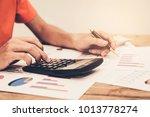 a man's hand holding pen... | Shutterstock . vector #1013778274