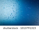 water drop on blue background | Shutterstock . vector #1013791315