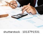 a businessman analyzing... | Shutterstock . vector #1013791531
