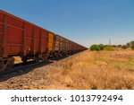 long iron ore freight train ... | Shutterstock . vector #1013792494