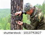 foresters install cameras of a... | Shutterstock . vector #1013792827