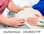 midwife or nurse in delivery... | Shutterstock . vector #1013831779