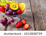 ripe fruits on a transparent... | Shutterstock . vector #1013838739