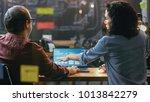 male and female financiers look ...   Shutterstock . vector #1013842279