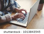female hands typing at keyboard ... | Shutterstock . vector #1013843545