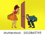man and woman looking through a ... | Shutterstock .eps vector #1013865745