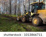 a bulldozer clears the site for ... | Shutterstock . vector #1013866711