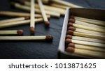 matches in box  dark background.... | Shutterstock . vector #1013871625