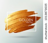 a golden brush stroke in the... | Shutterstock .eps vector #1013873035
