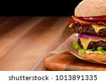close up on double cheeseburger ... | Shutterstock . vector #1013891335