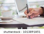 business man hand holding pen... | Shutterstock . vector #1013891851