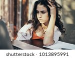 business woman in a cafe... | Shutterstock . vector #1013895991