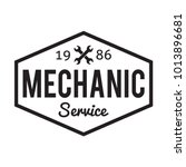 mechanic service. garage badge. ... | Shutterstock .eps vector #1013896681