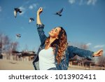young women enjoy freedom on... | Shutterstock . vector #1013902411