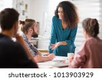 meeting at the office. a... | Shutterstock . vector #1013903929